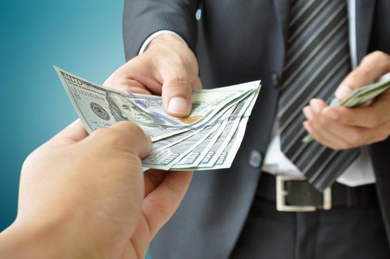 lawyer handing over money
