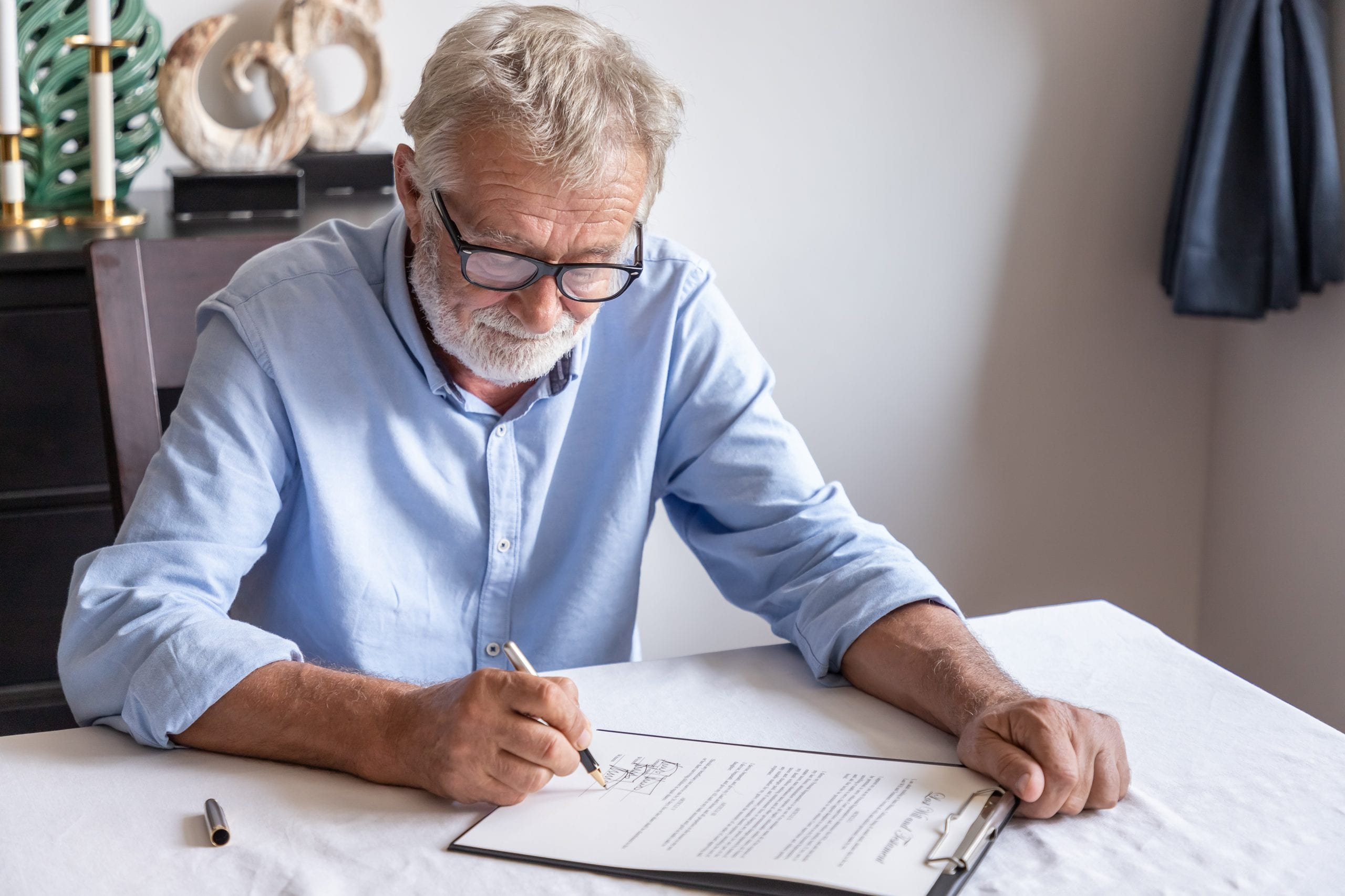 old man signing documents