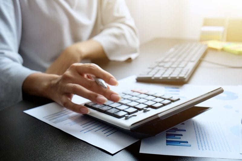 person performing financial calculations