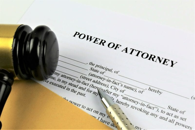 power of attorney with gavel and pen