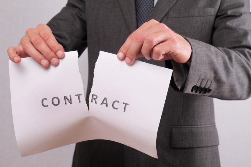 man tearing up contract